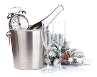 Champagne bottle in bucket, glasses and alarm clock Royalty Free Stock Photography
