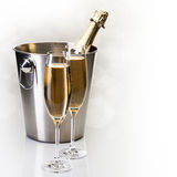 Champagne bottle in bucket with glasses of champagne Stock Images