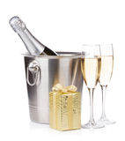 Champagne bottle in bucket, glasses and gift box. Isolated on white background Royalty Free Stock Images