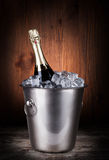 Champagne bottle in a bucket with ice Stock Image