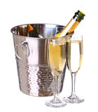 Champagne bottle in bucket with ice and glasses of champagne Stock Photography
