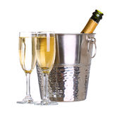 Champagne bottle in bucket with ice and glasses of champagne Royalty Free Stock Photo