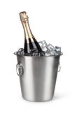 Champagne bottle in a bucket with ice Royalty Free Stock Photo