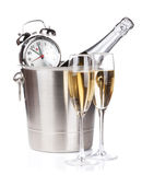 Champagne bottle in bucket, two glasses and alarm clock Royalty Free Stock Image