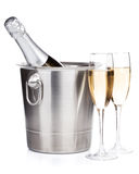 Champagne bottle in bucket and two glasses Stock Image