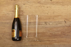 Champagne bottle and champagne glasses on wood Royalty Free Stock Photography