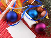 Champagne bottle with christmas ball and blue ribbon, invitation Royalty Free Stock Photo