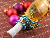 Champagne bottle with Christmas balls and diamonds Royalty Free Stock Photos