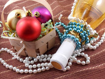 Champagne bottle with Christmas balls and diamonds Stock Images