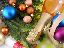 Champagne bottle and christmas balls, Merry Christmas and Happy New Year Royalty Free Stock Images