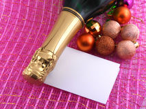 Champagne bottle and christmas decor. new year holiday card Royalty Free Stock Photography