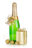 Champagne bottle, christmas gift and baubles Royalty Free Stock Photos