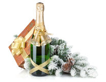 Champagne bottle, christmas gift box, decor and fir tree Royalty Free Stock Image