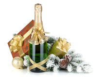 Champagne bottle, christmas gift box, decor and fir tree Stock Photo