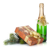 Champagne bottle, christmas gift box, decor and fir tree Royalty Free Stock Photos