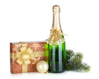Champagne bottle, christmas gift box, decor and fir tree Royalty Free Stock Photography