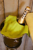 Champagne bottle cool down in bucket photo Royalty Free Stock Image