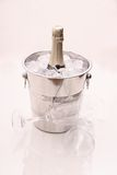 Champagne bottle in cooler and two champagne glasses Royalty Free Stock Photo