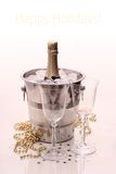 Champagne bottle in cooler and two champagne glasses Stock Photography