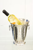 Champagne bottle in cooler Stock Photo