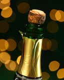 Champagne bottle and cork. With bokeh lights background Royalty Free Stock Image