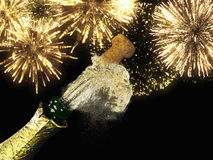 Champagne bottle and cork with lit firework. A Champagne bottle and cork with lit firework Stock Photo