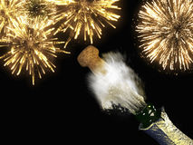Champagne bottle and cork with lit firework. A Champagne bottle and cork with lit firework Stock Photos
