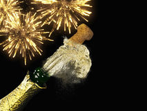 Champagne bottle and cork with lit firework. A Champagne bottle and cork with lit firework Royalty Free Stock Photos