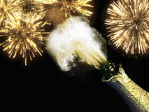 Champagne bottle and cork with lit firework. A Champagne bottle and cork with lit firework Stock Image