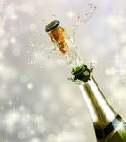 Champagne Bottle Explosion. Over Holiday Background Royalty Free Stock Photography