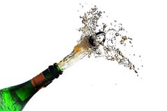 Champagne bottle explosion with cork popping splash isolated aga. Inst a white background, copy space, selected focus, motion blur Royalty Free Stock Photos