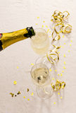 Champagne bottle fills glasses Stock Photography