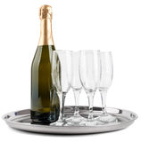 Champagne bottle and four glasses Royalty Free Stock Image