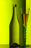 Champagne bottle & glass. An empty bottle and a glass of champagne Stock Images