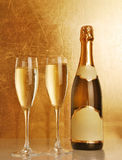 Champagne bottle and glass. On abstract background Royalty Free Stock Image