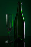Champagne bottle with glass Royalty Free Stock Images