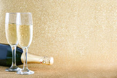 Champagne bottle with glass cups Royalty Free Stock Photography