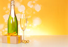 Champagne bottle, glass and gift Royalty Free Stock Photography