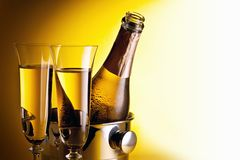 Champagne bottle and glasses Stock Images