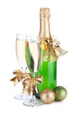 Champagne bottle, glasses and christmas decor Royalty Free Stock Images