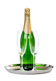 Champagne bottle with glasses on the tray Royalty Free Stock Photo