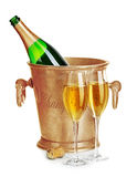 Champagne bottle in golden ice bucket with glasses of champagne close-up  on a white background. Festive still life. Royalty Free Stock Photography