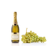 Champagne bottle and grapes Royalty Free Stock Photos