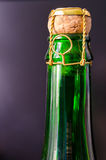 Champagne bottle. Green champagne bottle with cork closeup Royalty Free Stock Photos