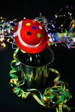 Champagne bottle with hat, black background. New year Stock Images