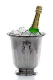 Champagne bottle on ice Royalty Free Stock Photography
