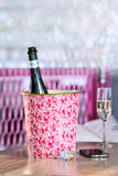 Champagne bottle in ice bucket and champagne glass in bar Stock Photos