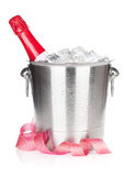 Champagne bottle in ice bucket and christmas decor Royalty Free Stock Photography