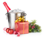 Champagne bottle in ice bucket, two empty glasses and christmas Royalty Free Stock Images