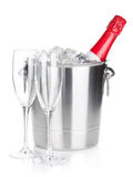 Champagne bottle in ice bucket Royalty Free Stock Photos